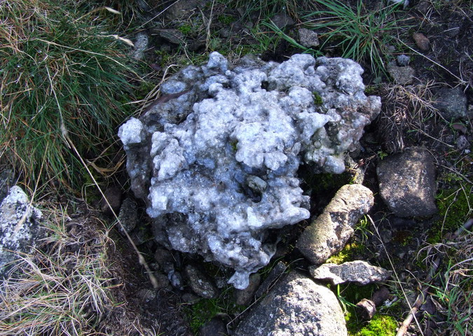 One of the many lumps of fused aluminium scattered around the site