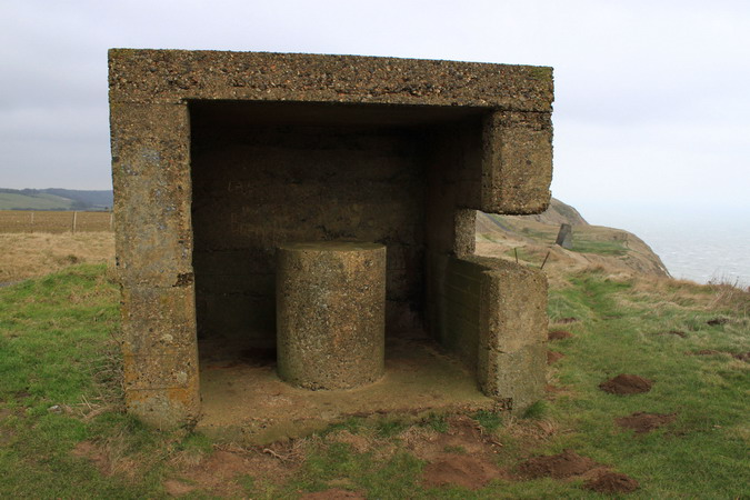 Concrete structure with the acoustic mirror in the background (middle right)