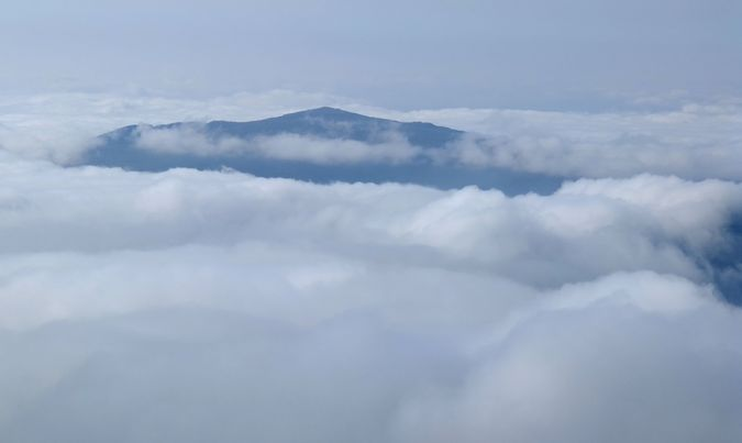 Moel Siabod shrouded in cloud, from Carnedd Llewelyn