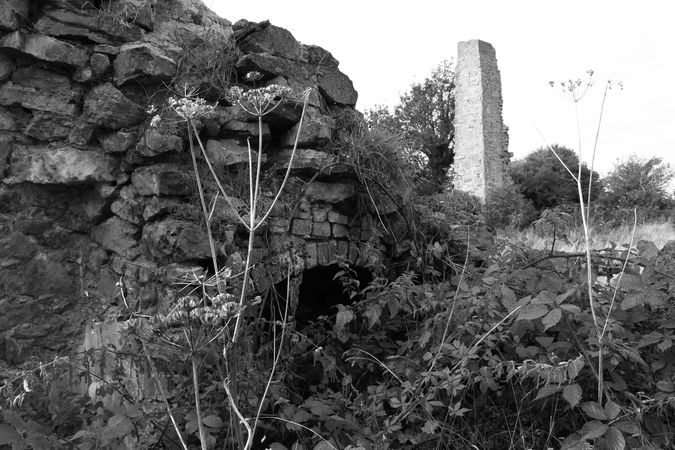 Cottage with steam-engine chimney in the background, Berw Colliery