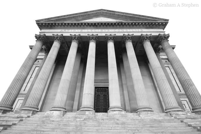 Southern portico with double row of eight Corinthian columns.  The inscription reads 'Artibus Legibus Consiliis Locum Municipes Constituerunt Anno Domini MLCCCXLI' (For Arts, Law and Counsel the townspeople built this place in 1841)