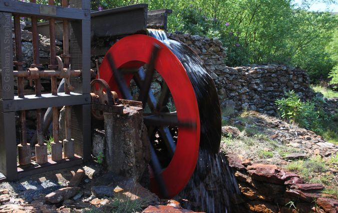 Half-scale water wheel and stamp battery for crushing ore