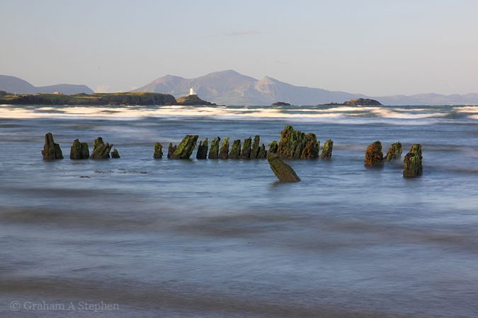 The wreck of the Athena, with Ynys Llanddwyn in the background