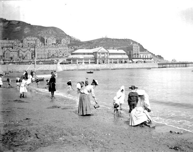 North Shore Beach, Llandudno, with Llandudno Pier Pavilion Theatre (middle) and the  Baths Hotel (right) in the background
