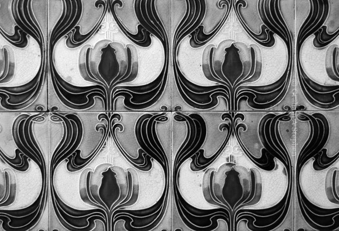 Splashback detail.  Tiled washstands were popular in middle-class Victorian and Edwardian bedrooms.  The splashbacks not only protected the walls from splashes but also provided a decorative feature.