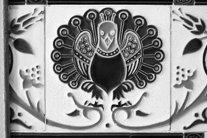 Detail, Majolica tile panel produced by Maw & Co and shown at the 1867 Paris Exhibition.  The peacock tile is by John Moyr Smith.