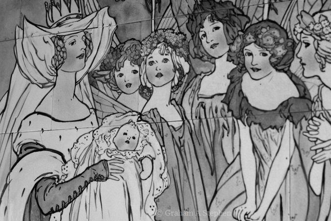 Fairies at the Christening by Margaret E Thompson for Doulton & Co (c 1905).  A hand-painted tiled panel with a scene from Sleeping Beauty was created for a children's ward in a hospital.