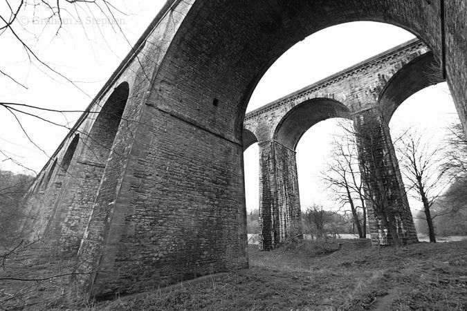 Looking through one of the aqueduct's 10 arches towards its companion railway viaduct
