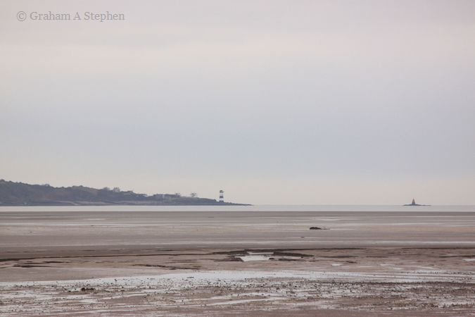 Trwyn Du Lighthouse and Perch Rock from Morfa Aber