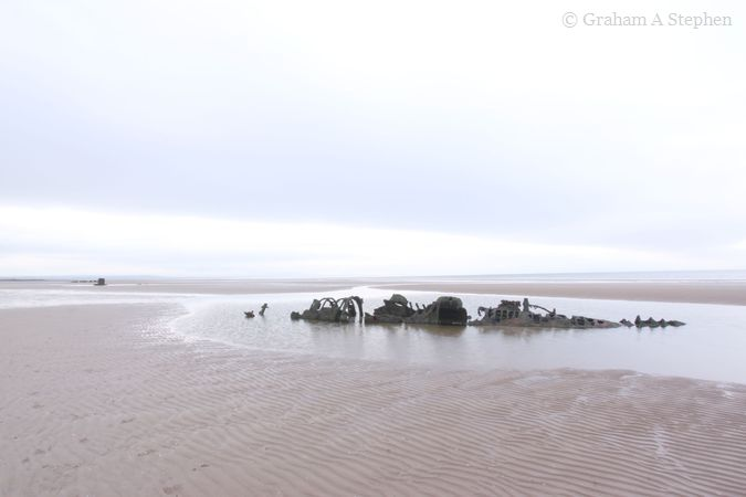 The northerly wreck with the southerly one and the central concrete block off in the distance (middle left)